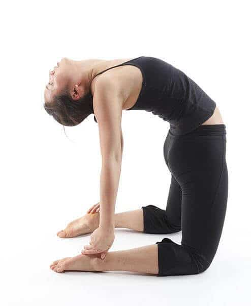 A woman doing the yoga Camel Pose known as Ustrasana