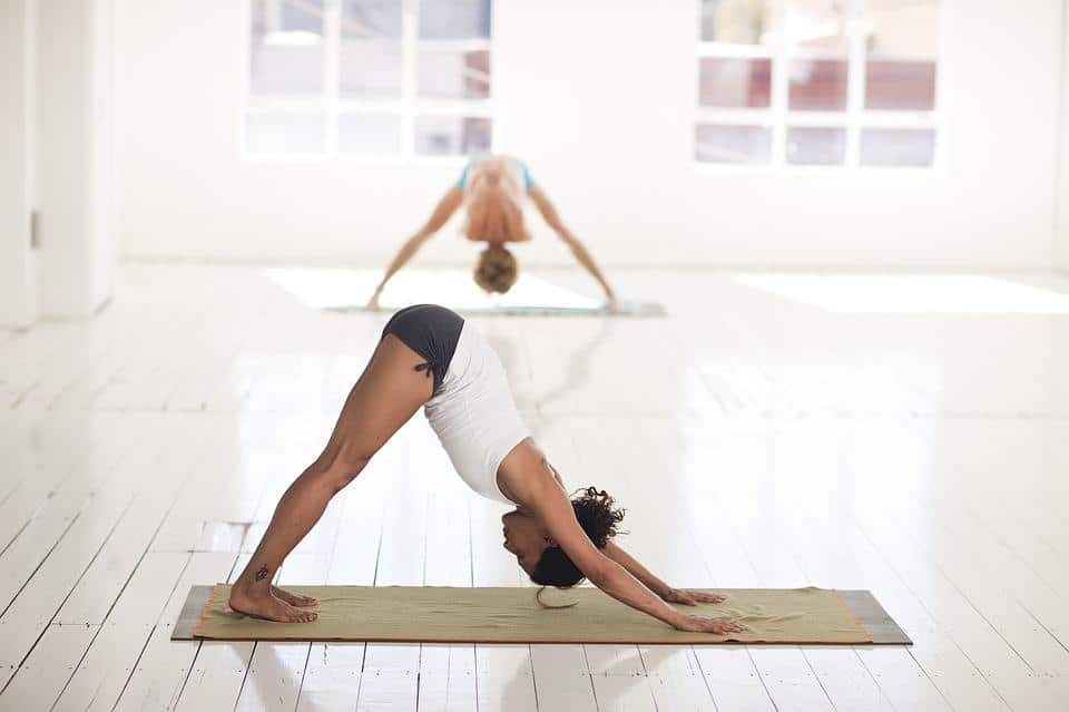 A woman doing the yoga Inversion Pose also known as downward facing dog